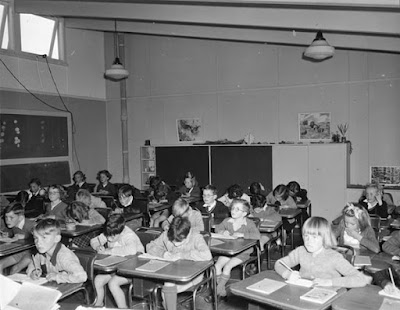School children busily writing in classroom, Narrabundah, 1953