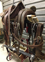 Leather saddle, harnesses and other horse gear.