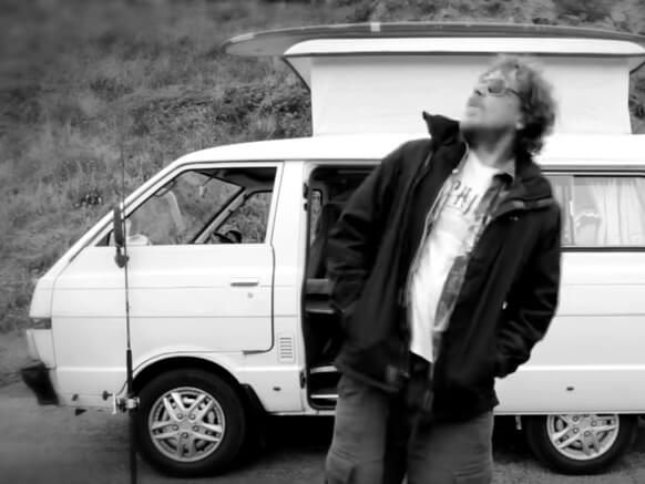 Fergus O'Donnell stands before his vanagon in #Vanlife Documentary