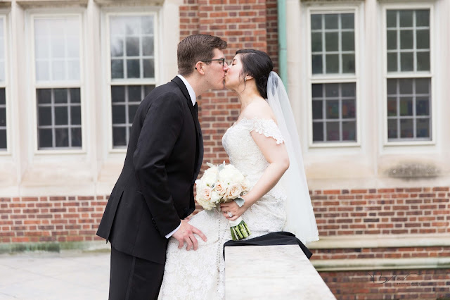 bride and groom kissing at Grosse Point Academy
