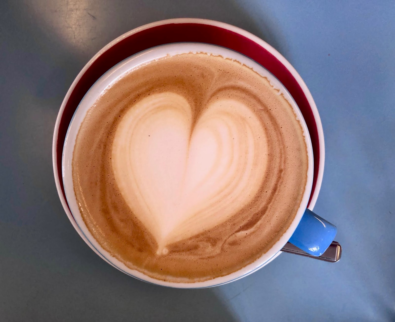 Coffee latte with heart pattern in the milk
