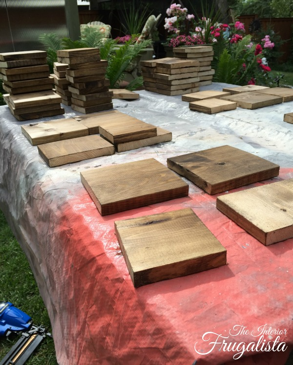 Pine fence boards cut and stained to make Rustic Wedding Centerpieces
