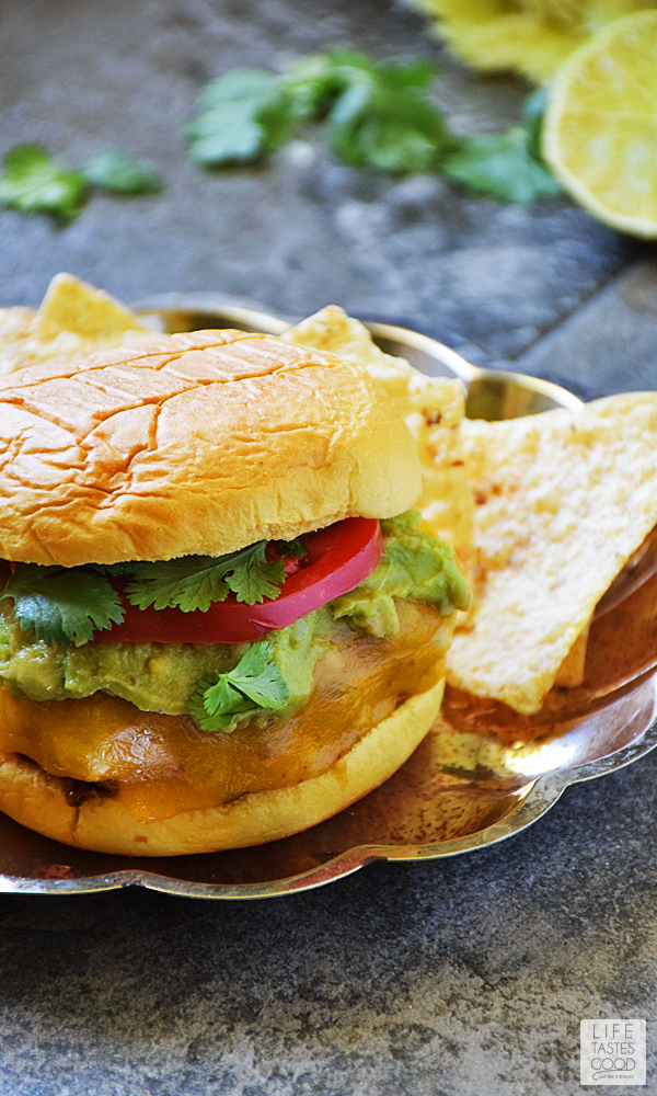 Guacamole Cilantro Lime Cheeseburger | by Life Tastes Good is an easy recipe using fresh ingredients to maximize flavor! A Mexican inspired burger perfect for a summer bbq, lunch, dinner, or even a pool party! #LTGrecipes #SundaySupper