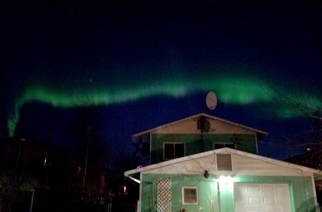 Aurora Borealis aka northern light dancing in the sky right above my house