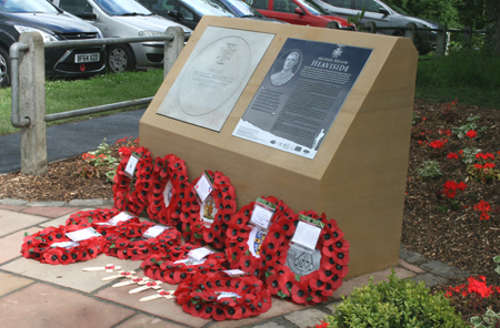 The Heaviside VC paving stone and information panel, with wreaths placed after the unveiling (Photo by Durham County Record Office)