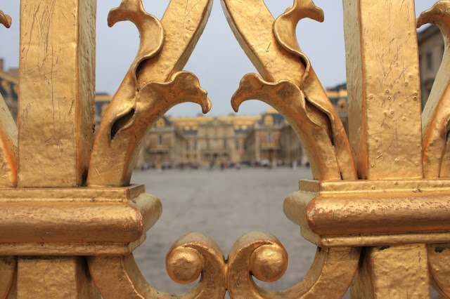 The front of Versailles shot through the front gate.