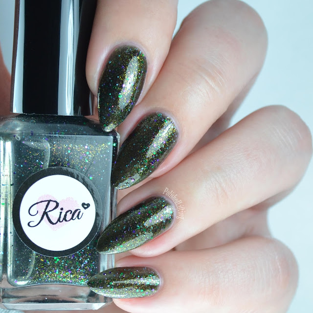 black nail polish with green and blue glitter