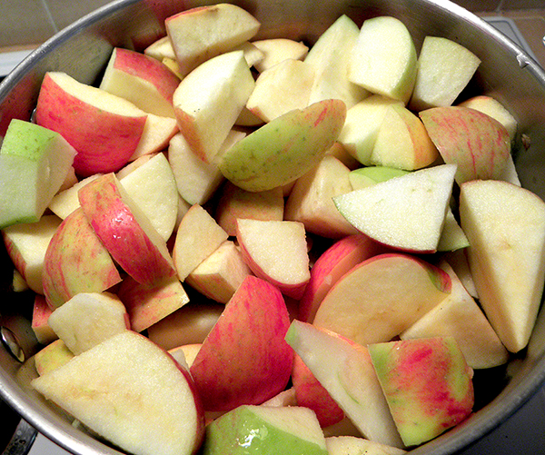 Pot Filled with Apples and Cinnamon Sticks