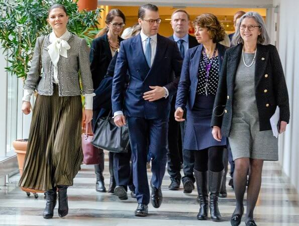 Crown Princess Victoria wore Mayla tweed jacket, H&M pleated midi skirt, and carries Valentino Small chain shoulder bag