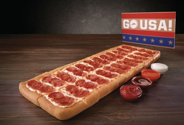 Pizza Hut's new limited-time Big Dipper Pizza is a big rectangular pan pizza or two medium rectangular pan pizzas placed inside a large rectangular box depending on how you look at it. It's also a sauceless pizza or an order of 24 cheesesticks, again, depending on how you look at it.
