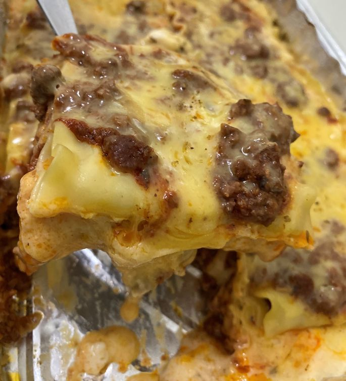 Getting a serving of baked lasagna from House of Lasagna