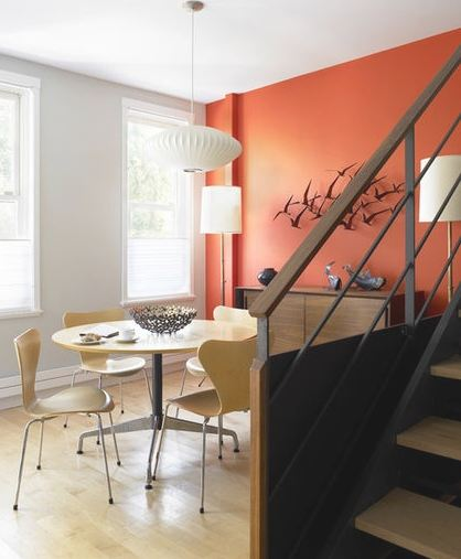 bold painted accent wall adds a bit of spice to the space.