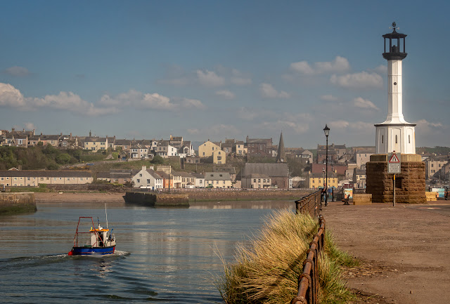 Photo of a small fishing boat returning home to Maryport on Sunday