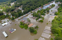 Floodwaters submerged a subdivision in north Baton Rouge on Aug. 15, 2016. (Credit: Bill Feig/The Advocate) Click to Enlarge.