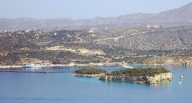 "Nisi and Leon in Suda Bay, Crete.  In ancient times these two islets were referred to as Leukai (Greek for ""white ones"")."