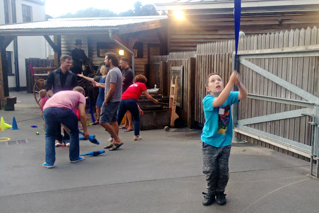 A group practicing circus skills on the dockside