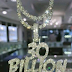 DAVIDO SHOWS OFF HIS NEW DIAMOND ENCRUSTED '30 BILLION GANG' CHAIN (PHOTO)