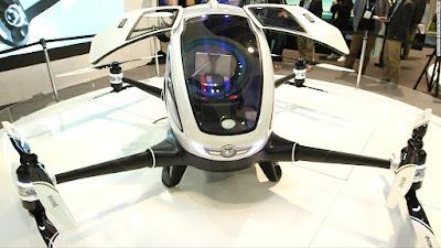 Car Size Drone merupakan Drone yang bisa dinaiki manusia dan dilengkapi dengan kamera dan bahan bakar ramag lingkungan