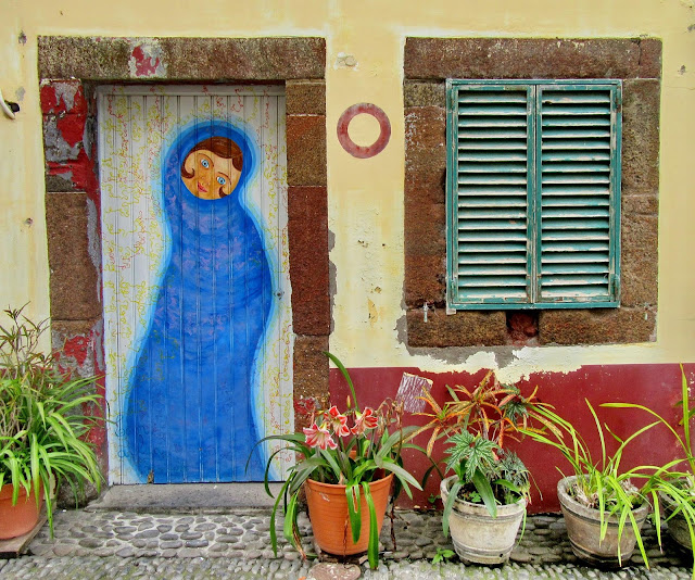 the lady in blue at the door painted in Old Town