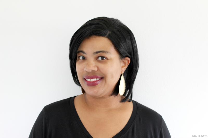 a black woman wearing an equal freetress black wig