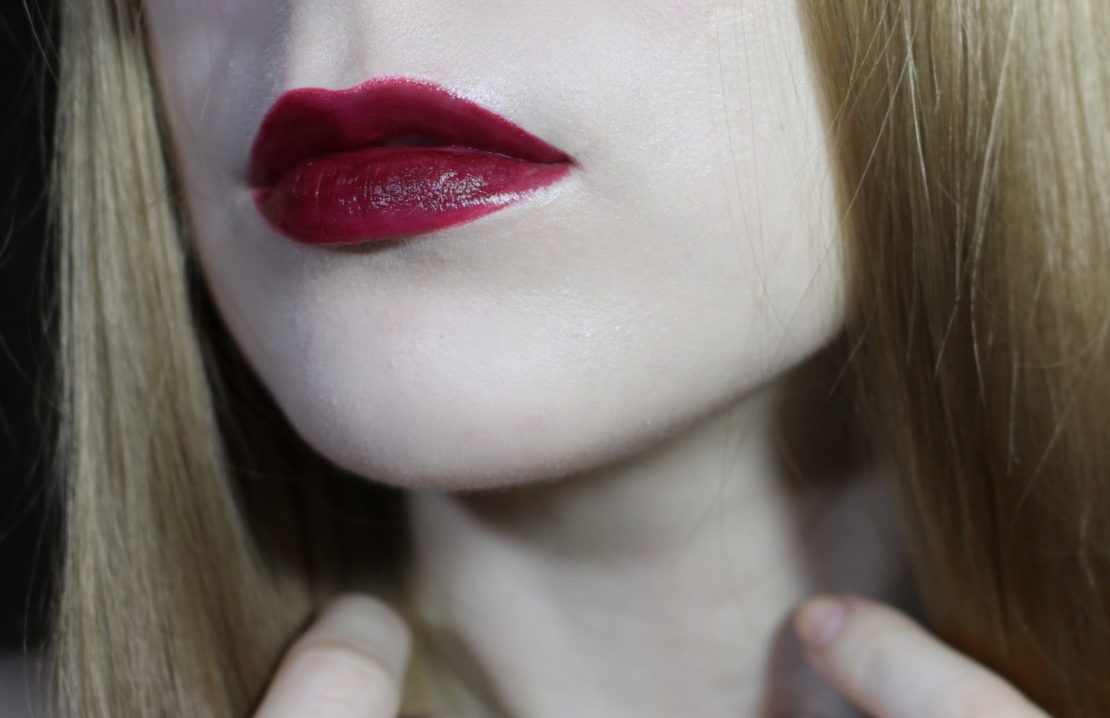 blonde girl with dark red lipstick
