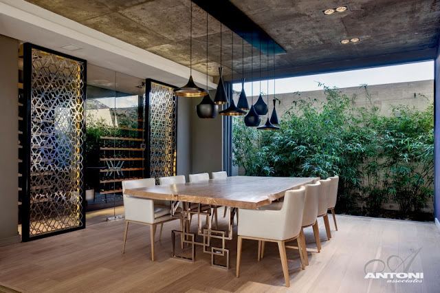 Modern dining room with open glass wall