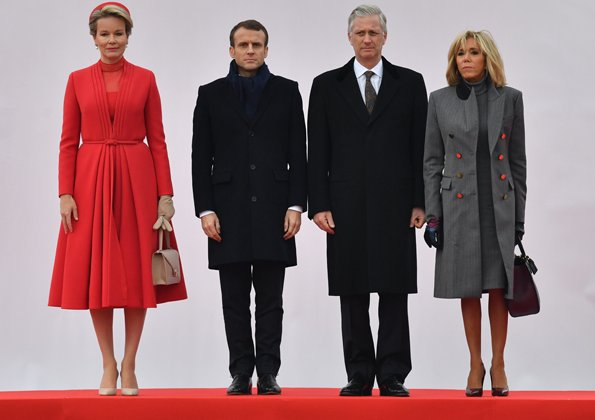 Queen Mathilde wearing a Christian Dior couture coat dress. Brigitte Macron wore Ralph Louren coat, dress and pumps