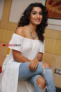 Kannada Model Actress Krishi Thapanda Stills in Ripped Jeans at Eradu Kanasu Movie Press Meet  0010.jpg