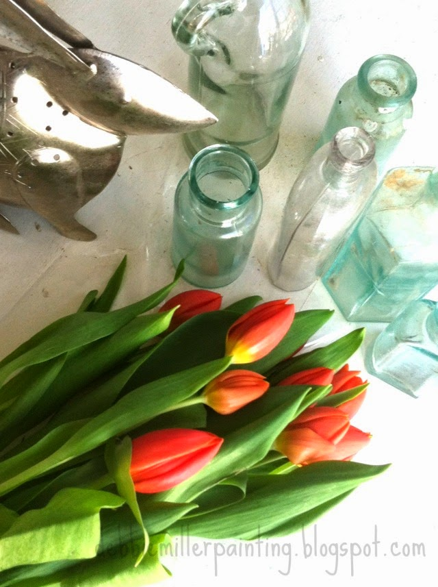 orange tulips and old bottles