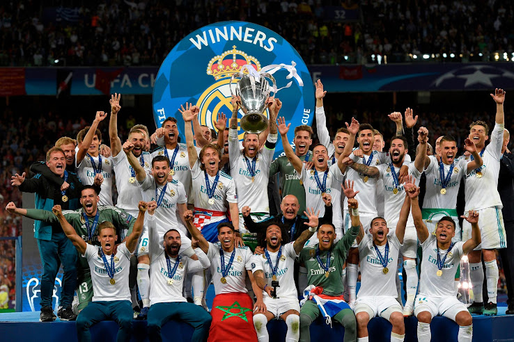 92cf3c7e Are you happy to see Real Madrid take home another Champions League trophy?  Drop us a line below. Real Madrid UCL 2018 Winners T-Shirt