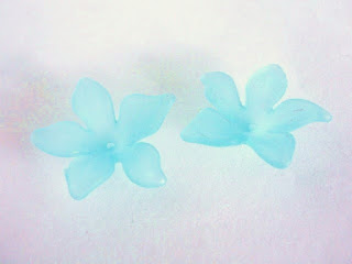 http://www.beads2string.com/collections/flower-leaf-acrylic/products/frosted-blue-flower-beads-29mm-clematis-acrylic