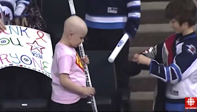 Boy gives hockey stick to cancer-fighting Winnipeg girl