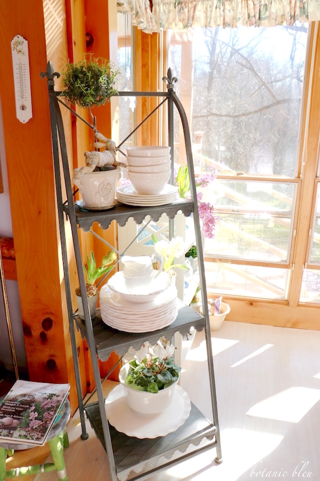 french-style-plant-stand-with-white-dishes