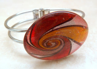 http://www.kcavintagegems.uk/foiled-glass-spiral-design-bangle-5381-p.asp