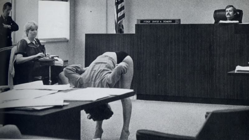 Court photo circa 1980. Adult entertainer bending over and demonstrating to the judge that she did not indecently flash customers because her underwear provides adequate coverage. The Court reporter and attorney also assess the view. Court Humor 'Judgmental' marchmatron.com