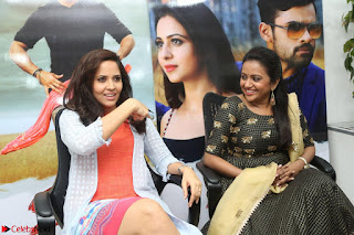 Actress Suma in Black Salwar Suit and Anusuya in orange Dress at winner movie press meet part 2 February 2017 (5).JPG