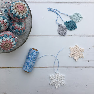 Bowl of crochet baubles and other crochet decorations