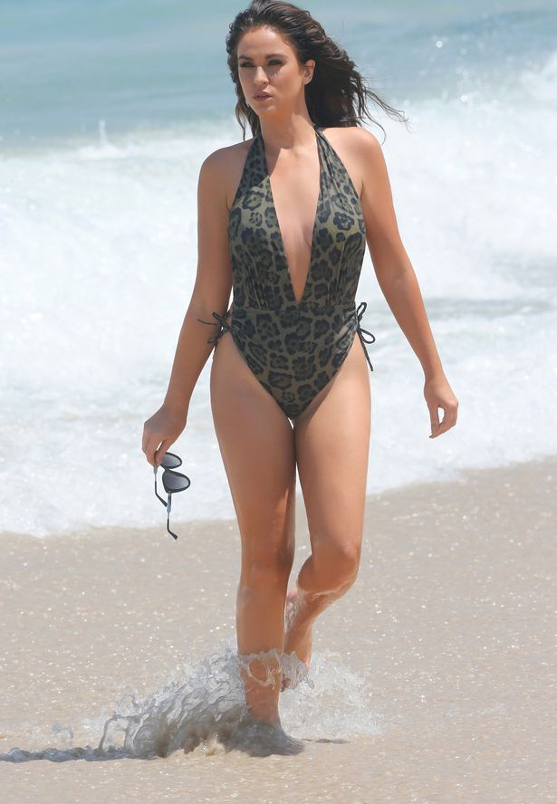 EMB-PAY-EXCLUSIVE-Vicky-Pattison-seen-on-a-beach-in-Australia-wearing-a-green-patterned-swimsuit
