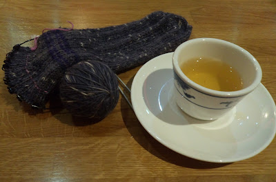 Cup of jasmine tea and a half knit sock