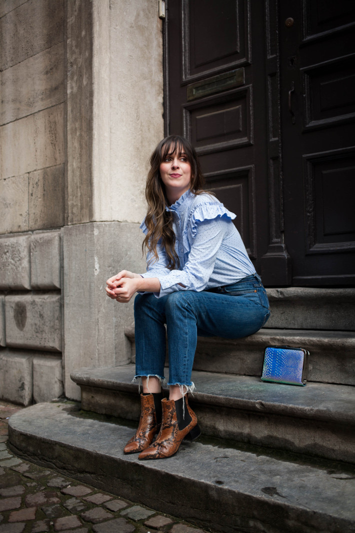 Outfit: ruffle blouse, raw hem denim, snakeskin chelsea boots