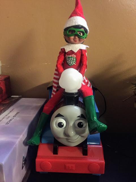 Elf doll riding a train toy