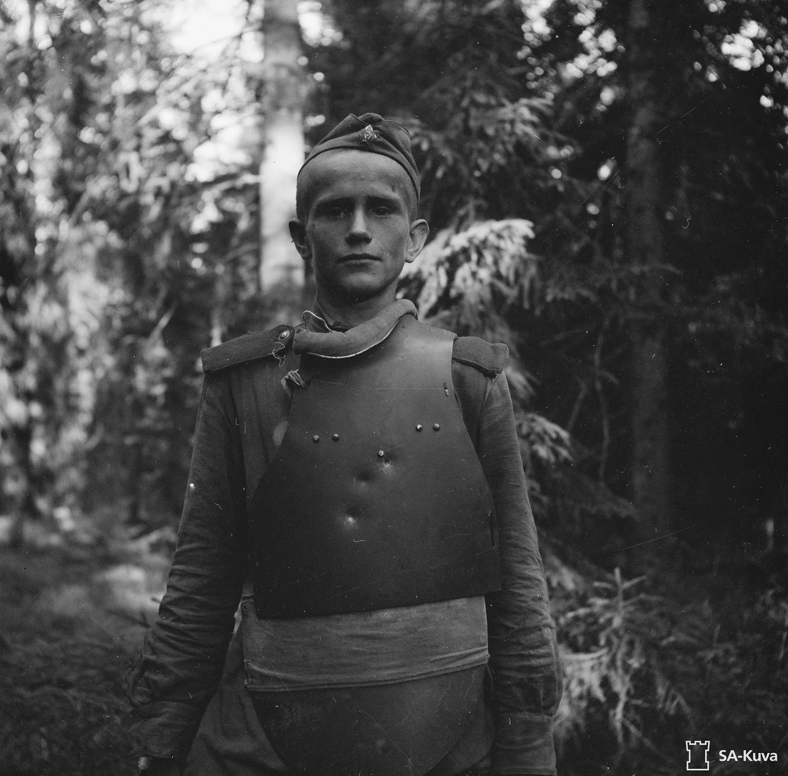 Captured Soviet soldier dressed in SN-42 body armor. Karelia, 1944.