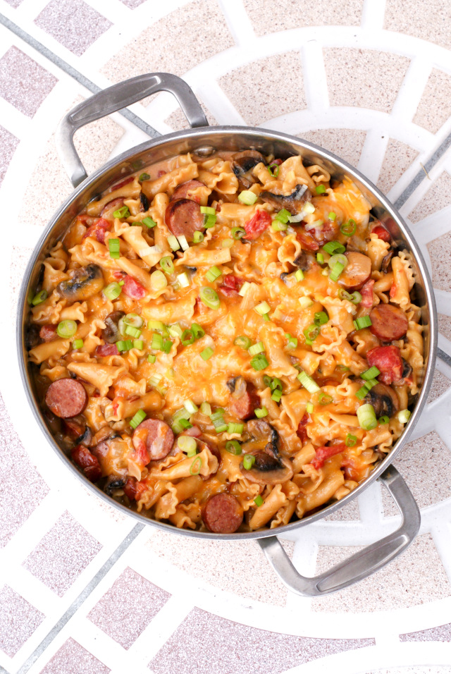 One Pot Cheesy Kielbasa Pasta is an easy to make skillet meal that that features lean turkey kielbasa, pasta, veggies, and lots of melty cheese.  The best part is that it all cooks in just one pot!