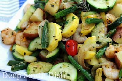 A skillet meal made from the best of summer veggies - squash, zucchini, bell pepper, green beans, Vidalia onions and tomatoes, with red potatoes and fresh garden herbs and the addition of some pan-seared fresh wild-caught Gulf shrimp.