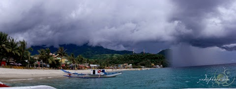 Rain approaching the coastline in White Beach Puerto Galera.