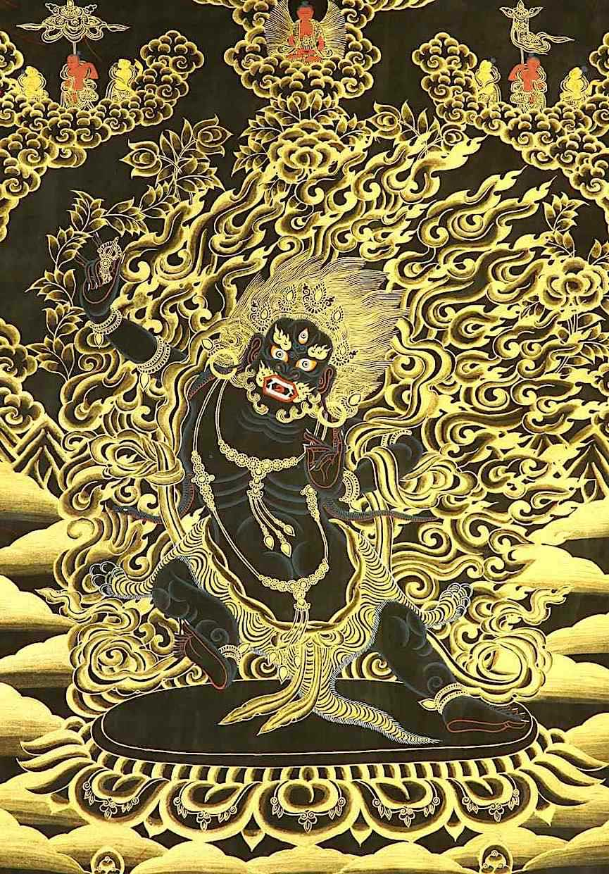 a Buddhist image of a demon or god in golden flames on cloth