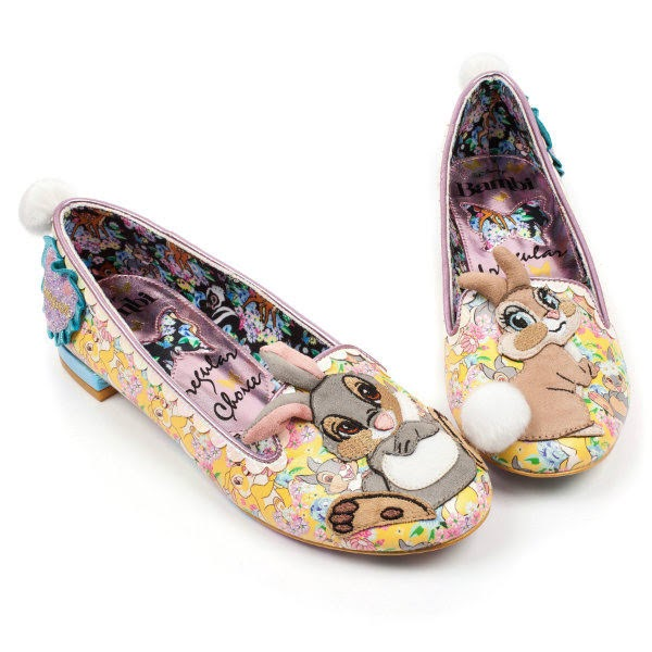 pair of yellow bunny shoes with toes touching