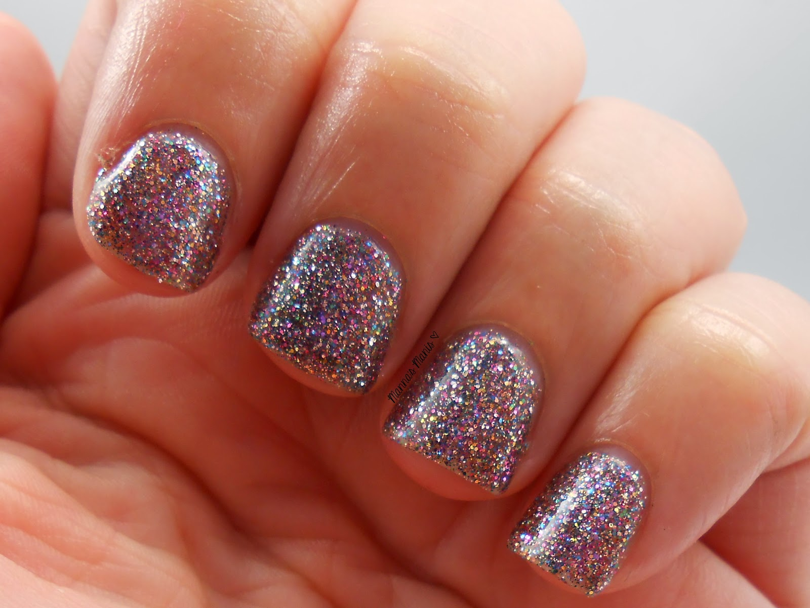 fingerpaints glisten here, a full coverage multicolored microglitter nail polish