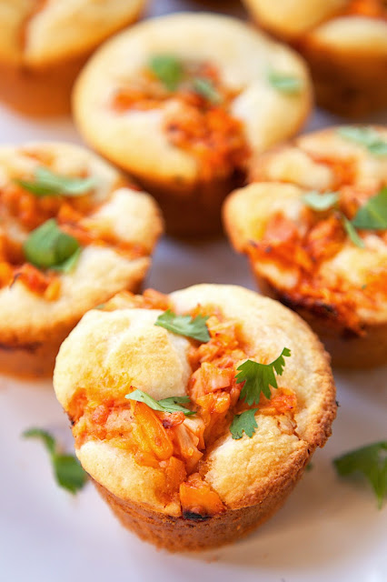 BBQ Chicken Cornbread Muffins - only 5 ingredients and ready to eat in under 30 minutes! Martha White Buttermilk Cornbread Mix, milk, cooked chicken, BBQ sauce and cheddar cheese. Top muffins with extra BBQ sauce and cilantro. SO good! The whole family gobbled these up! They have already been requested again for dinner.