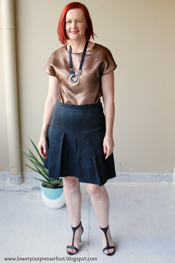 copper top and black silk skirt